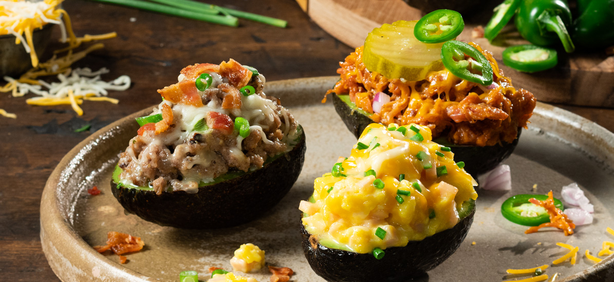 Avocado Boats with eggs, pulled pork, hamburger and Sargento Shredded Cheese